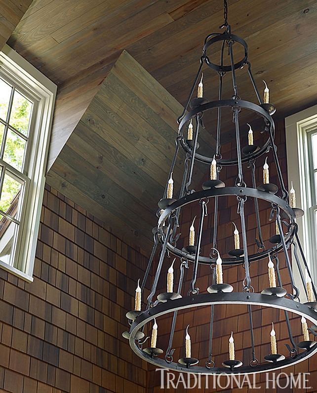 Wrought Iron Chandelier. Wrought Iron Chandelier Ideas. The gracious three-tiered Wrought Iron Chandelier is from Laura Lee Designs. It adds rustic elegance to the sunroom. #Chandelier. #WroughtIronChandelier