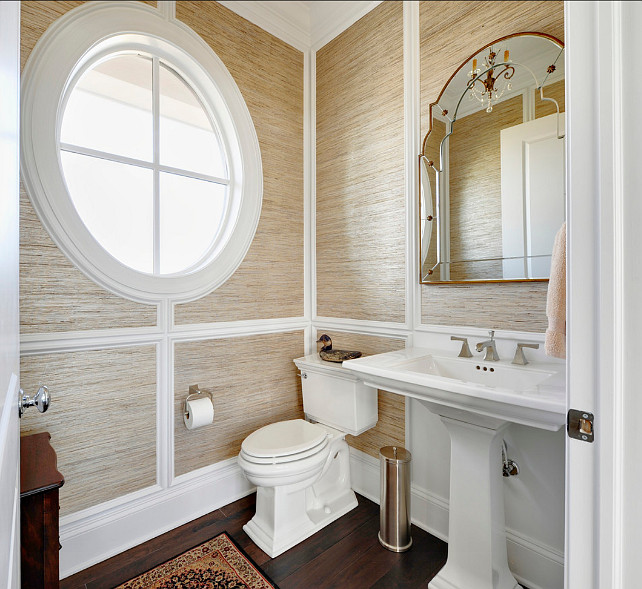 Powder Room. This powder room has grasscloth wallpaper on walls. The mirror is from Uttermost, Gella #12595 #Wallpaper #Grasscloth