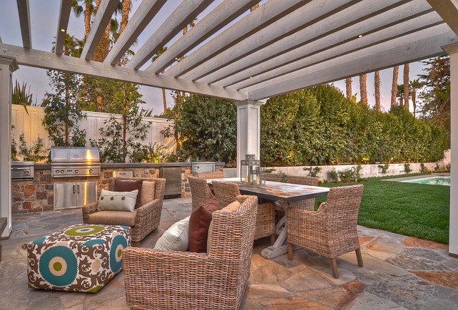 outdoor living. Comfortable outdoor furniture next to the swimming pool invites guests to enjoy life outdoors. The built in barbecue with rock wall detailing makes this space ideal for entertaining. #OutdoorSpaces