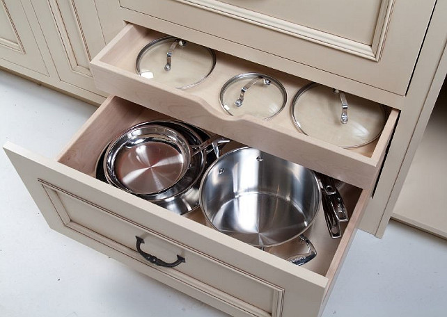 Kitchen cabinet storage. Great kitchen cabinet storage ideas for pans. #KitchenStorage #KitchenStorageSolutions