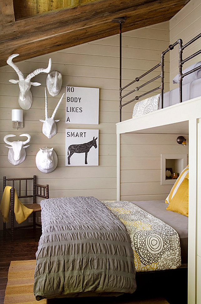Rustic Bunk Room with funny artwork. Gray and yellow bedroom with barn board ceilings over gray shiplap clad walls accented with a variety of faux taxidermy alongside Nobody Likes A Smart Ass Art. #BunkRoom #Art #Funny